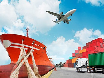 A ship, a plane and a heavy goods vehicle at a container port