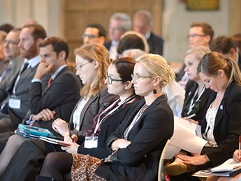 Conference delegates in an audience