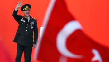 Turkey's Chief of the General Staff Hulusi Akar greets audience during the mass rally in Istanbul on August 7 after the failed July coup. (Reuters/Osman Orsal)